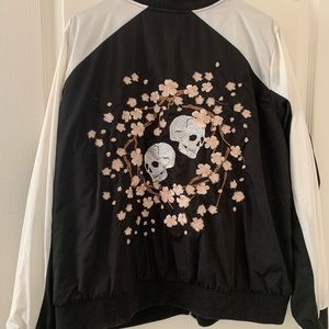 Embroidered skull and flower torrid jacket.